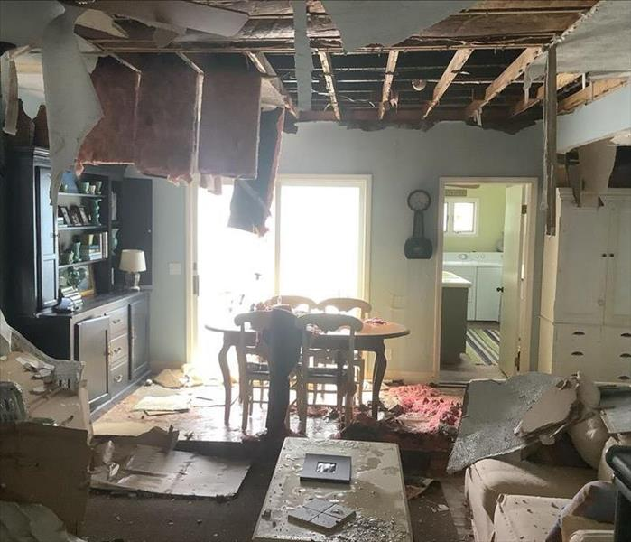 Extremely water damaged living room