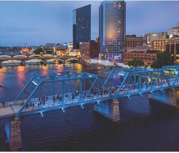 Ariel view of Grand Rapids Michigan. Image includes skyscrapers and blue bridge over the grand river.