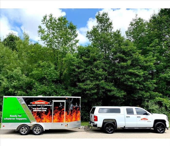 SERVPRO truck with storm trailer connected