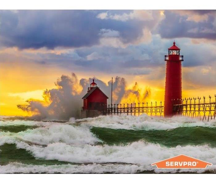 Grandhaven, Michigan lighthouse getting splashed with large waves